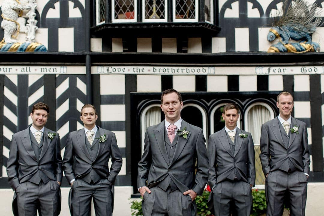 Groom and groomsmen outside Lord Leicester wedding venue in Warwickshire